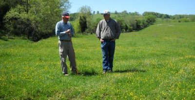 CMI private lands biologist in the field with a landowner.